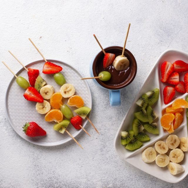 Sweet chocolate fondue with fruits